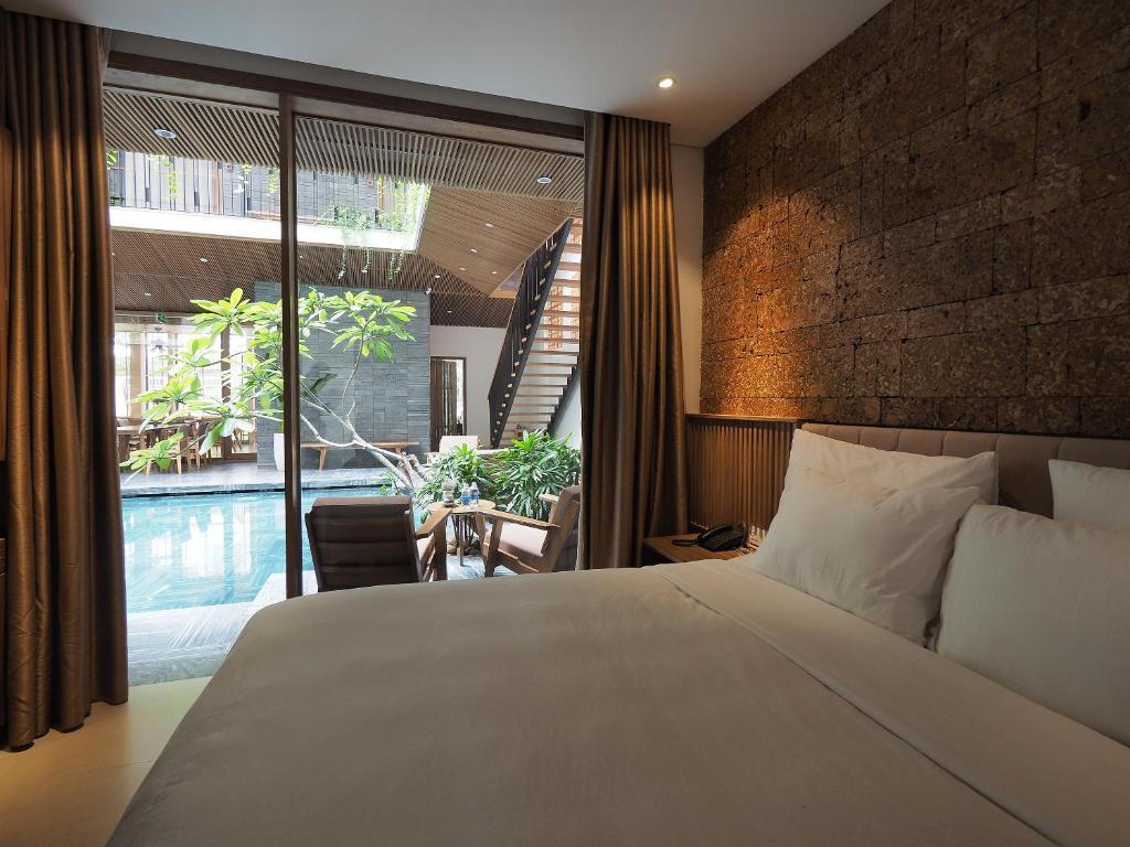 敏赫酒店客房内的一张或多张床位