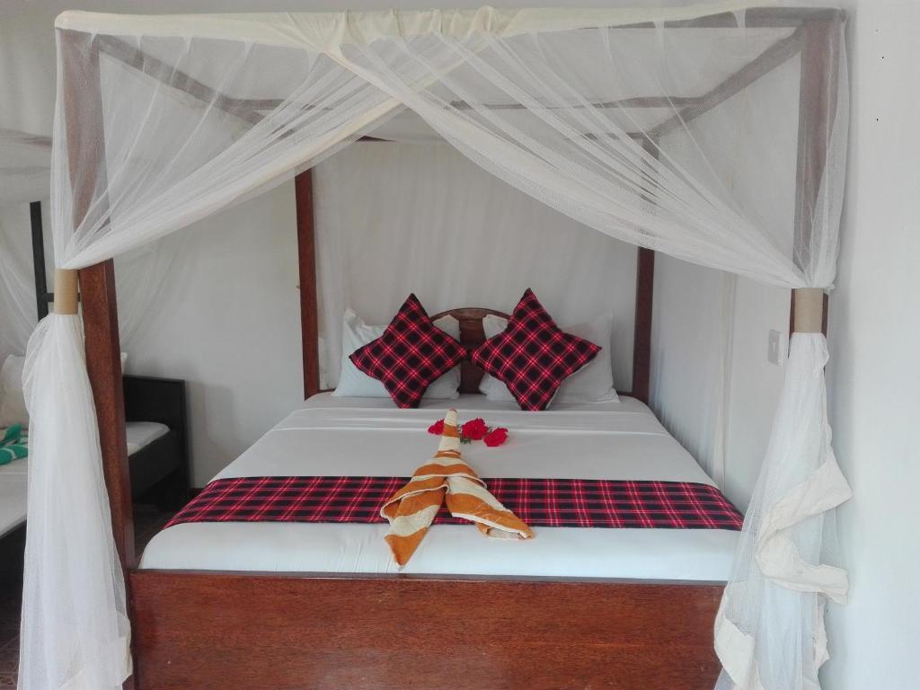 Kihori Bungalows客房内的一张或多张床位