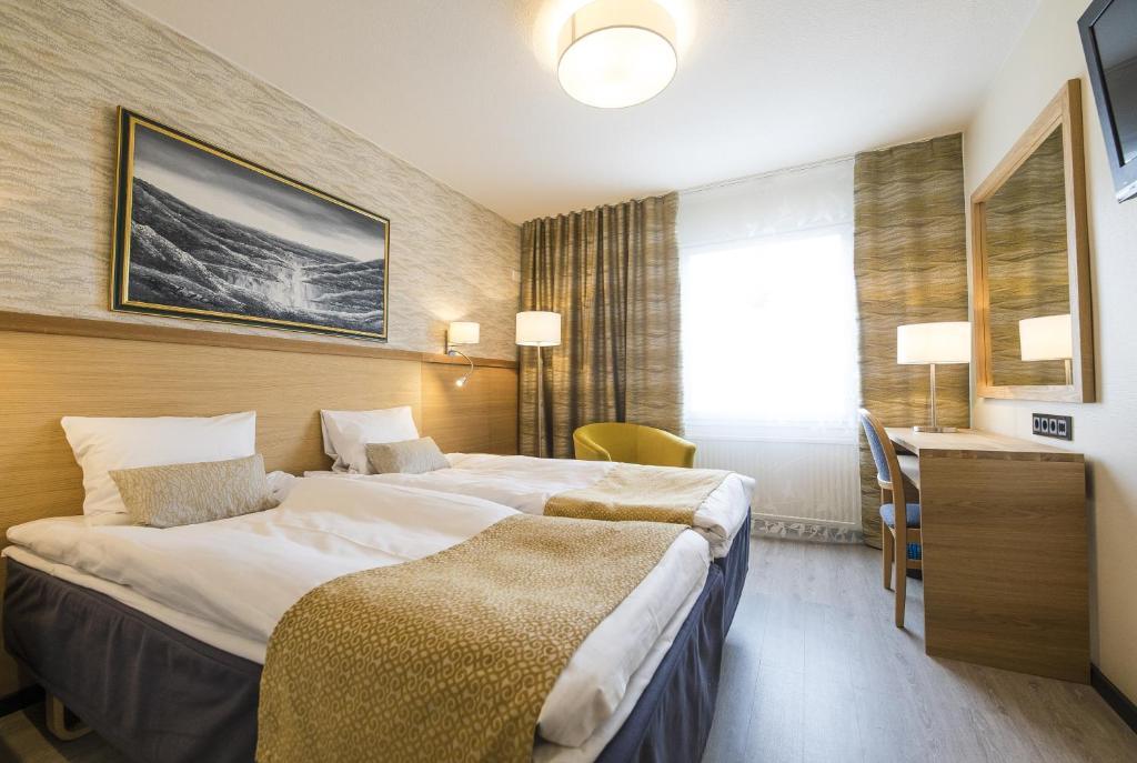 阿克努斯酒店客房内的一张或多张床位