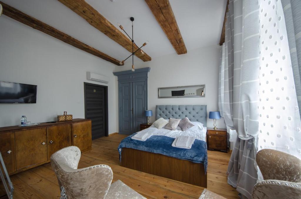 Apartamenty Mieszczańskie u Gołębiewskich客房内的一张或多张床位