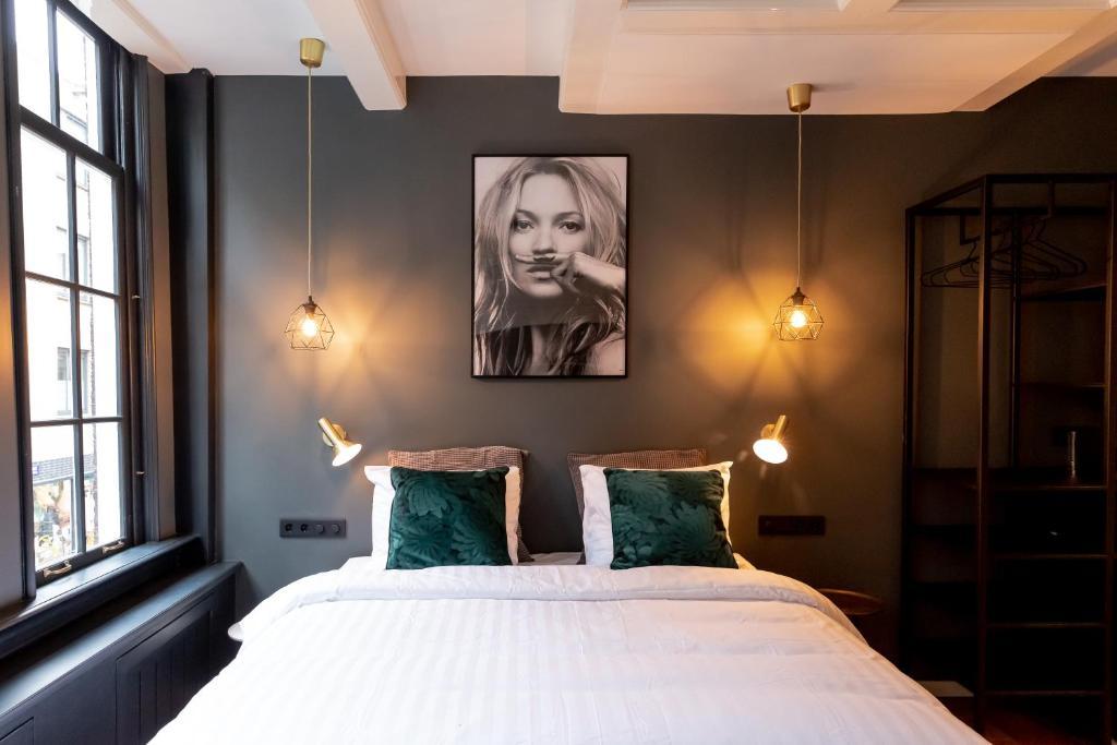 The Blossom House Amsterdam客房内的一张或多张床位