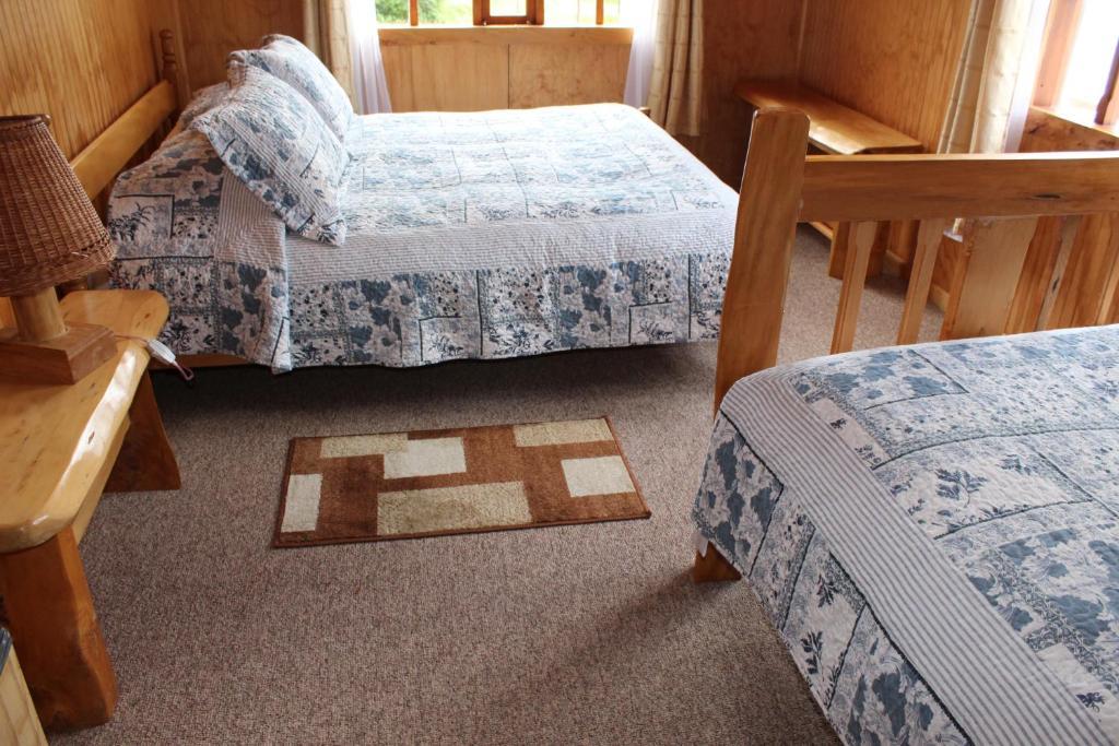 Los Mañíos Del Queulat客房内的一张或多张床位