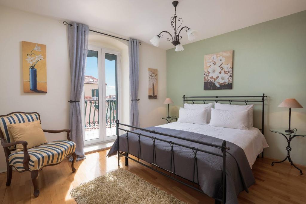 泽斐洛斯精品酒店客房内的一张或多张床位