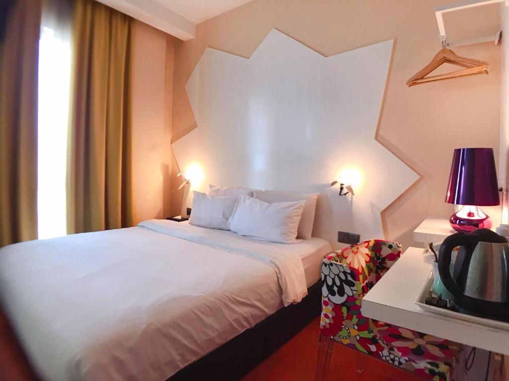 Melange Hotel Bukit Bintang客房内的一张或多张床位