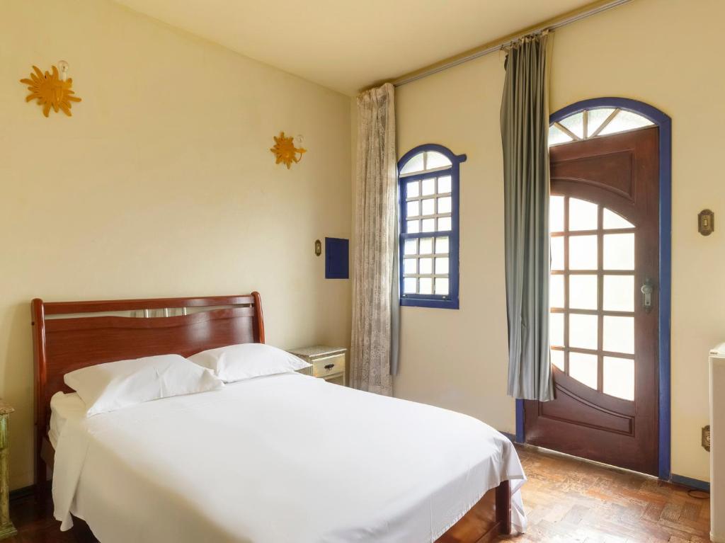 Pousada Morada Do Sol mg客房内的一张或多张床位
