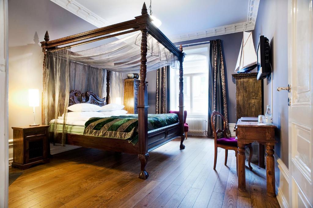 赫尔斯坦酒店客房内的一张或多张床位
