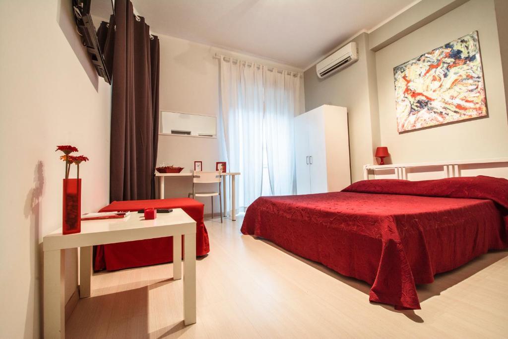 罗马的色彩酒店客房内的一张或多张床位
