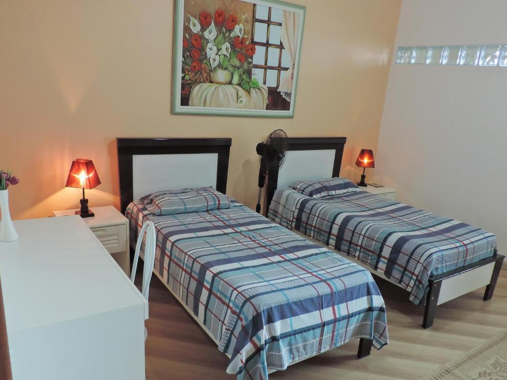 费米利恩原住住宿加早餐旅馆客房内的一张或多张床位