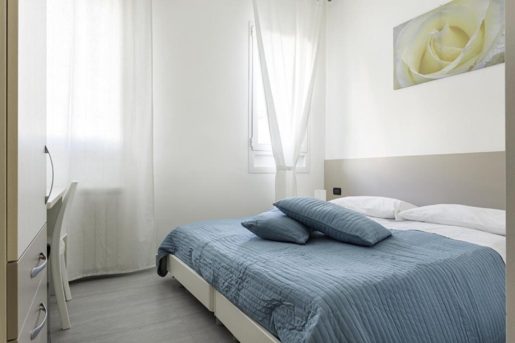 易威尼斯客房旅馆客房内的一张或多张床位