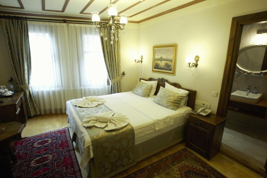 欧巴酒店客房内的一张或多张床位
