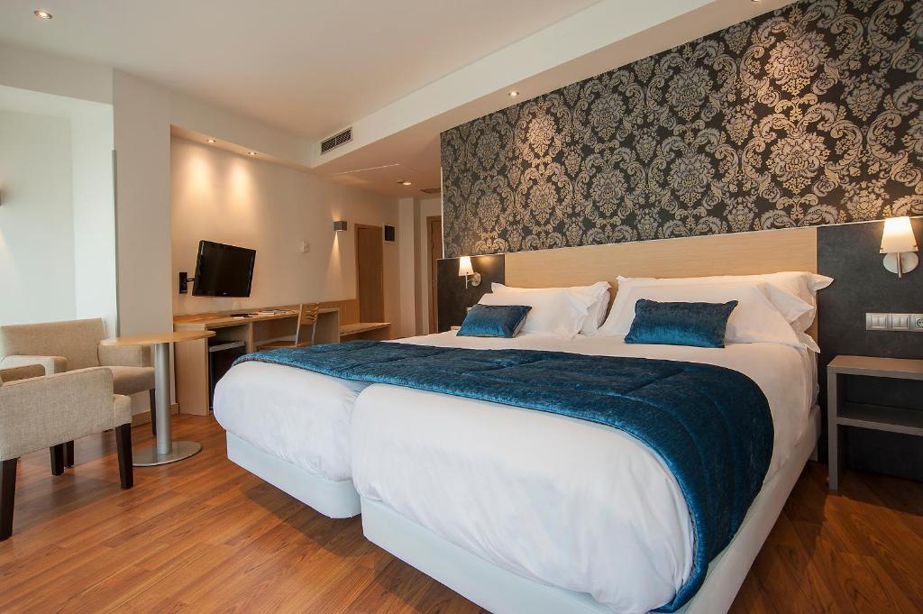斯考特而科迪纳酒店客房内的一张或多张床位