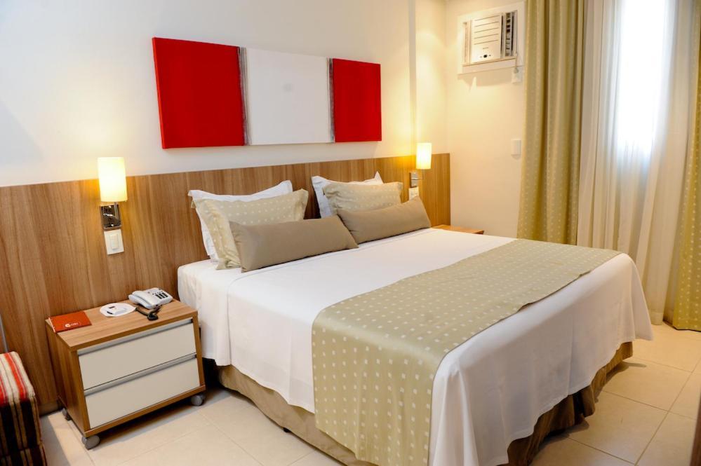 法利亚利马服务公寓酒店客房内的一张或多张床位