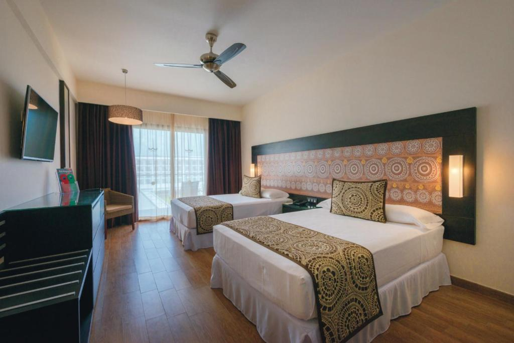 A bed or beds in a room at Riu Sri Lanka All Inclusive