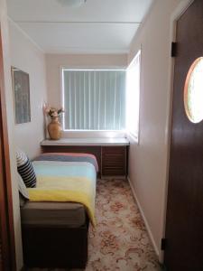Kaylee Cottage Mudgee客房内的一张或多张床位