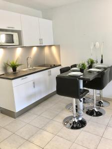 Appartement Avenue de la plage的厨房或小厨房