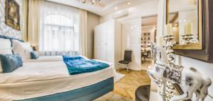 VIP Residence Danubius客房内的一张或多张床位