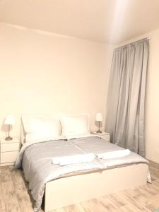 S&S Riverside Apartments客房内的一张或多张床位