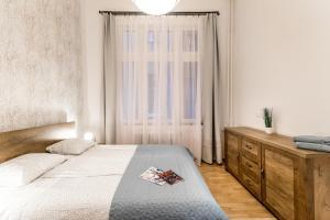 BpR Home of Revival Apartment客房内的一张或多张床位
