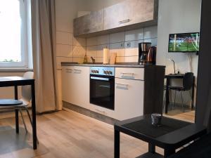 克瑞斯雷克林豪森赫腾公寓的厨房或小厨房