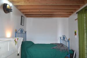 Casinha de Muda da Feteira客房内的一张或多张床位