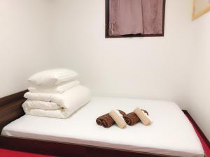 Guanjing Apartment客房内的一张或多张床位