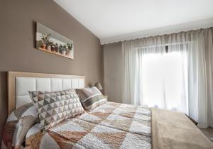 APARTAMENTO CONVENTO ENCARNACIÓN客房内的一张或多张床位