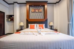 Anda Lamoon Villa Ao Nang客房内的一张或多张床位