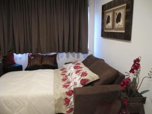 Apartamento Centro Solar da Colina客房内的一张或多张床位