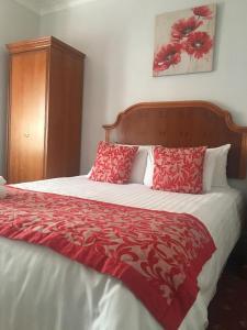索伦托酒店&餐厅客房内的一张或多张床位