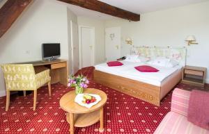 瓦赛博格安霍尔特罗曼蒂克酒店客房内的一张或多张床位