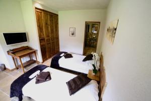 Chalet Arberons客房内的一张或多张床位