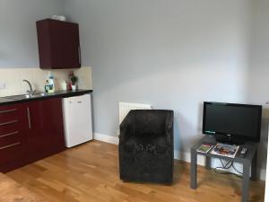 卡尔林公寓的电视和/或娱乐中心
