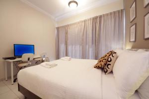 Signature Holiday Homes - Luxurious 1 Bedroom Apartment JLT, Dubai客房内的一张或多张床位