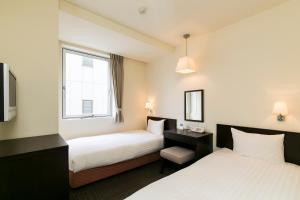 阿本特静冈酒店客房内的一张或多张床位