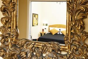 罗马之家豪华公寓客房内的一张或多张床位