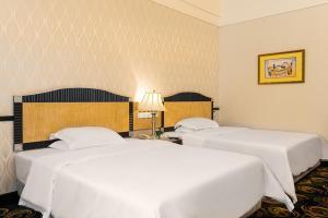 珠海骏德会酒店客房内的一张或多张床位