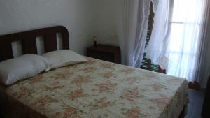 Casa no Peró客房内的一张或多张床位