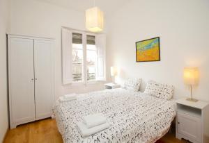高迪圣家堂酒店客房内的一张或多张床位