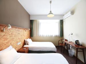 明堂上海南京路青年旅舍客房内的一张或多张床位