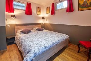 法国最小的房子度假屋客房内的一张或多张床位