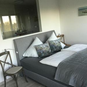 Haus Verando – Apartment Meeresrauschen客房内的一张或多张床位