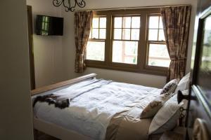 莨山住宿加早餐旅馆客房内的一张或多张床位