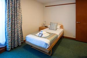 罗宾逊学院酒店 - 剑桥大学客房内的一张或多张床位