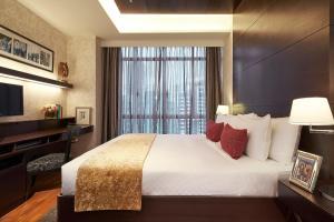 远东酒店集团乌节园公寓客房内的一张或多张床位