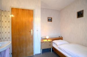 Ferienwohnung im Gästehaus Nussbaumer客房内的一张或多张床位