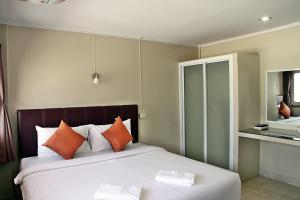 太平洋公寓式酒店客房内的一张或多张床位