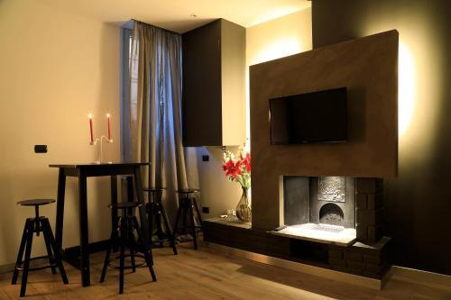 斯佛拉大教堂公寓的电视和/或娱乐中心