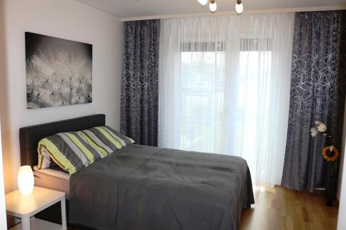 Komfort Apartments Alte Donau/Donauzentrum客房内的一张或多张床位