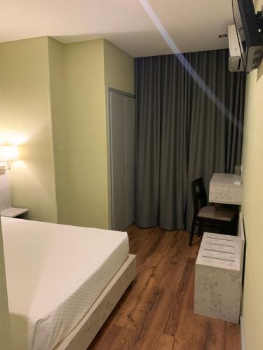 丰特鲁米诺萨酒店客房内的一张或多张床位