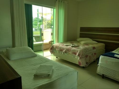 Pousada Praia do Trapiche客房内的一张或多张床位